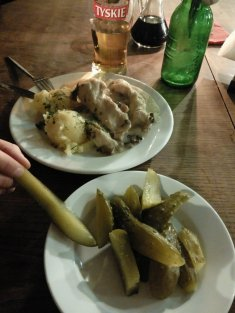 Pictured above and Below:  Pierogi Ruskie 8,50zł ($2.21 USD) Plate of Pickles, Zupa Grzybowa (Mushroom Soup w/ bread) 15,00zł ($3.89 USD) I believe the beer were 7,00zł ($1.82 USD) each.  A soup and a main dish at this restaurant cost 14,00zł ($3.63 USD).